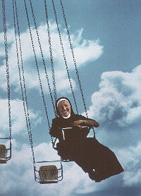 Nun has Heavenly Pleasure on riding swing caroussel